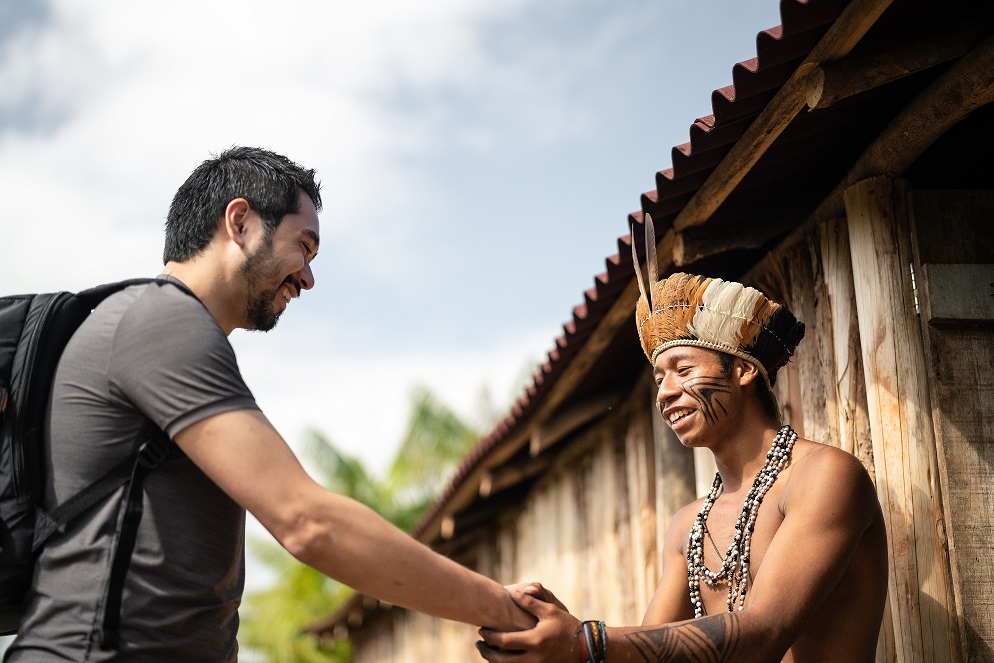 Indigenous Brazilian Young Man Portrait from Guarani ethnicity, Welcoming the tourist