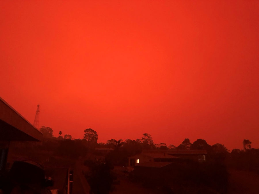 The sky glows red as surrounding wildfires close in on the town of Mallacoota, Victoria, Australia