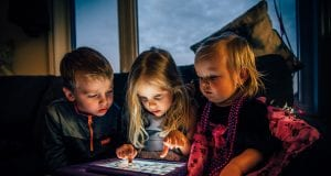 three children looking at a tablet computer 3536480